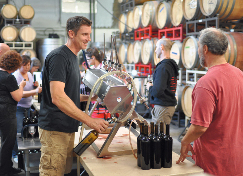 Winemaker bottling his wine